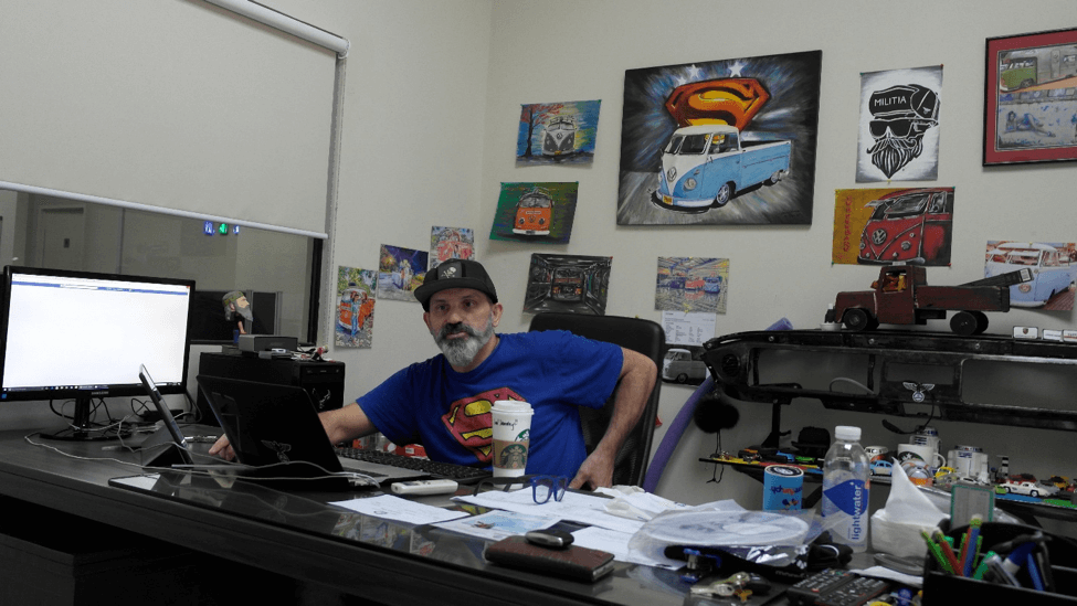 The mastermind Daniel Todd in his office - his avidness for the VW Kombi quite evident with the numerous illustrations of the classic car behind him